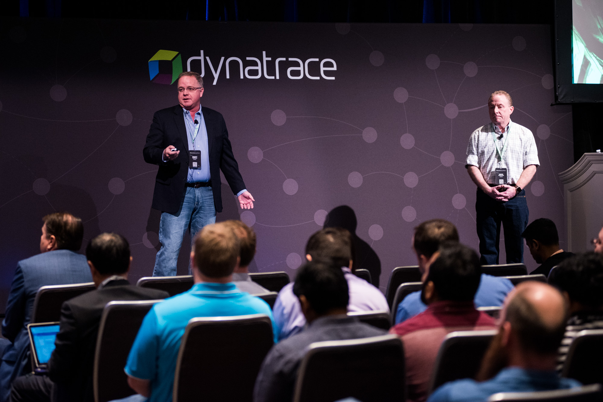 Two persons presenting at dynatrace perform breakout sessions