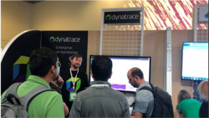 attendees get a demo at the Dynatrace booth